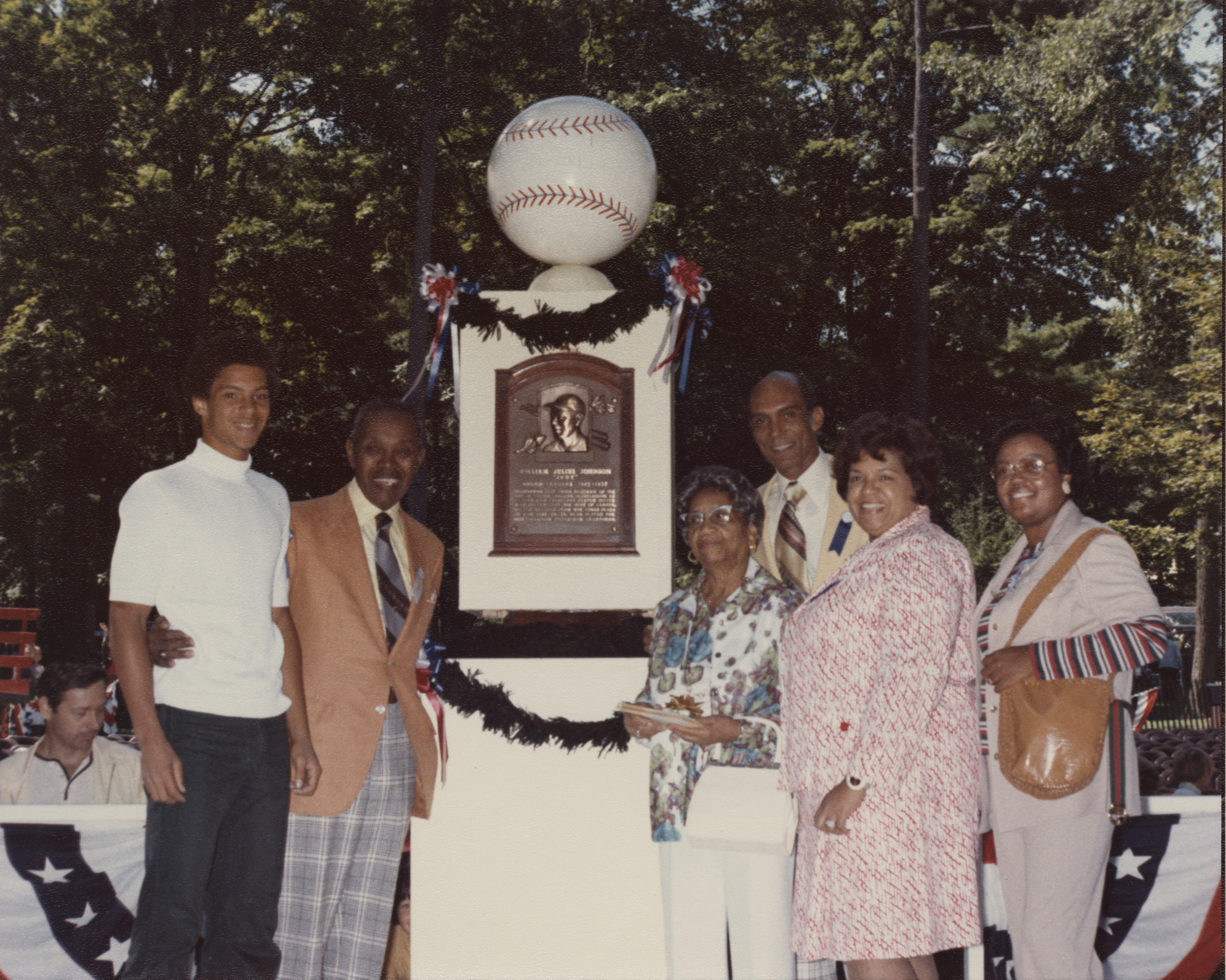 judy johnson elected to the hall of fame baseball hall of fame judy johnson standing in front of his plaque family members bl 549 2012 25 national baseball hall of fame library