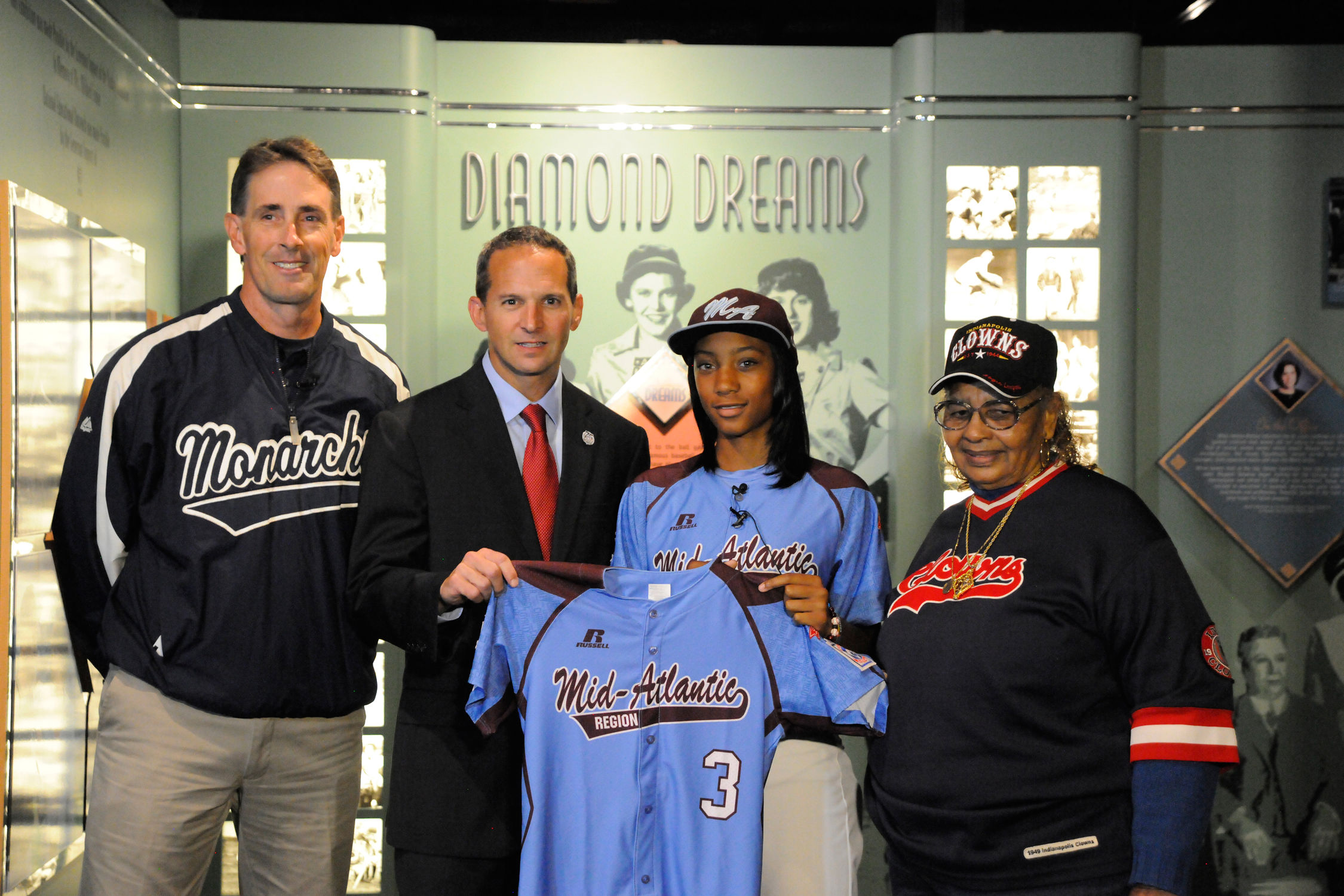 d6af627a2 Mo'ne Davis donated a jersey she wore at the 2014 Little League Baseball  World Series. She is seen here with (left to right) Steve Bandura,  founder/coach of ...
