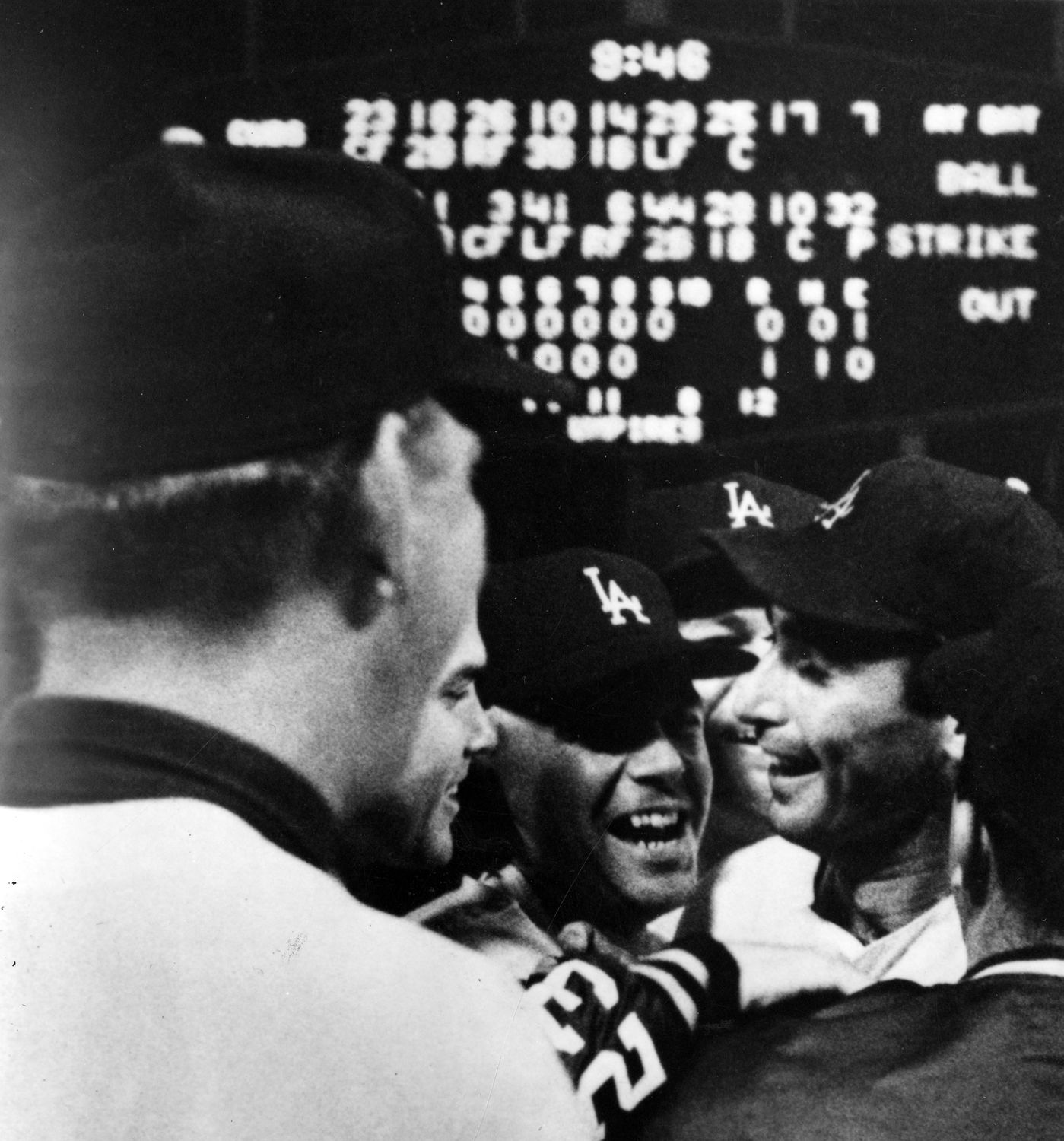 Dodgers pitcher Sandy Koufax is mobbed by teammates and coaches following  his perfect game against the Cubs on Sept. 9 7d2765841