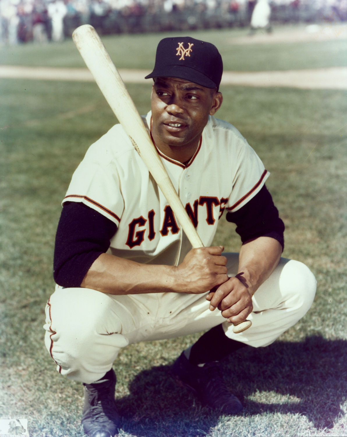 Monte Irvin of the New York Giants posed on the field with his bat 84a763db7