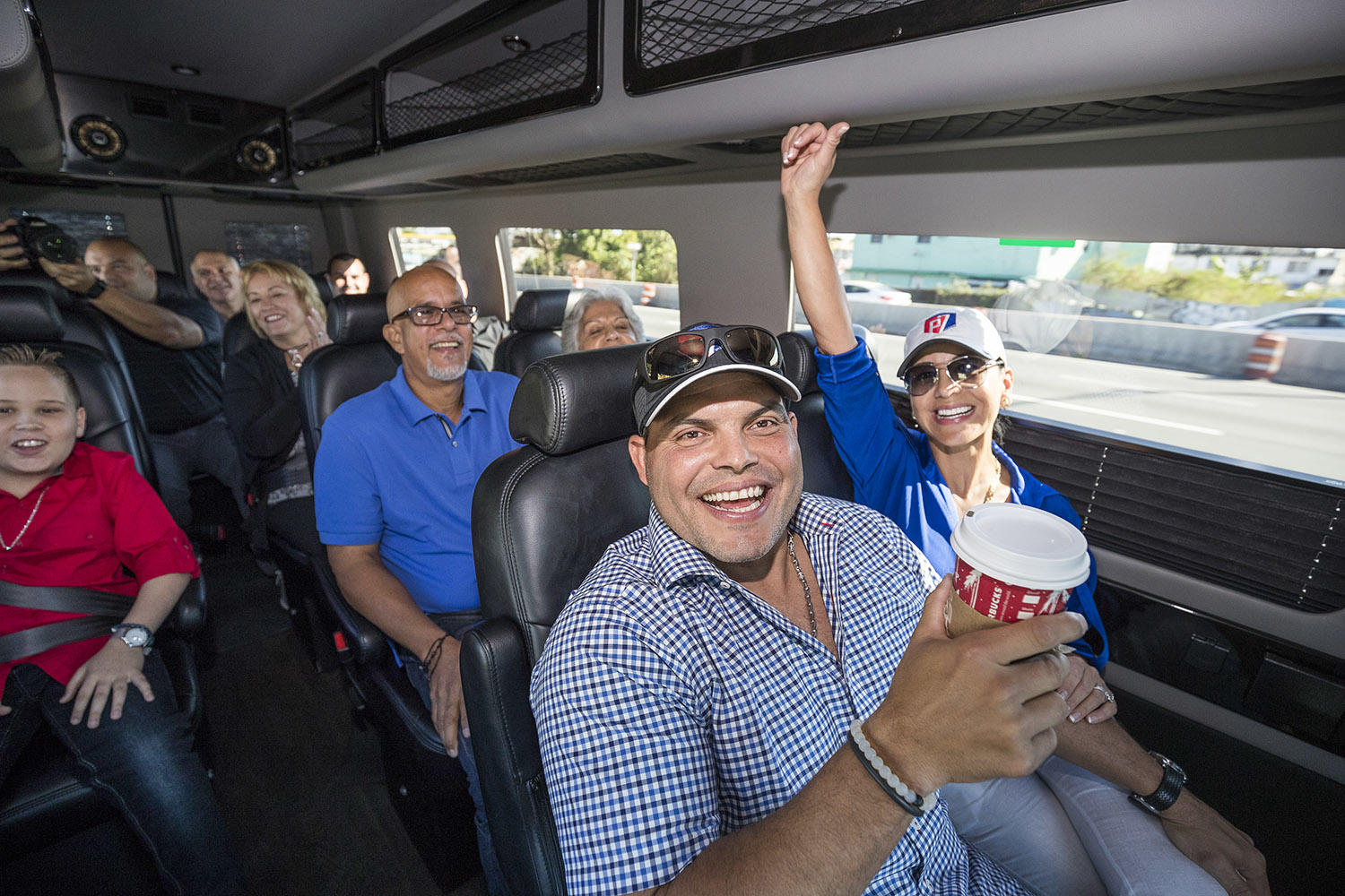 Iván Rodríguez (front) begins his celebratory return to Puerto Rico with his family, traveling across the island via bus. (Jean Fruth / National Baseball Hall of Fame)