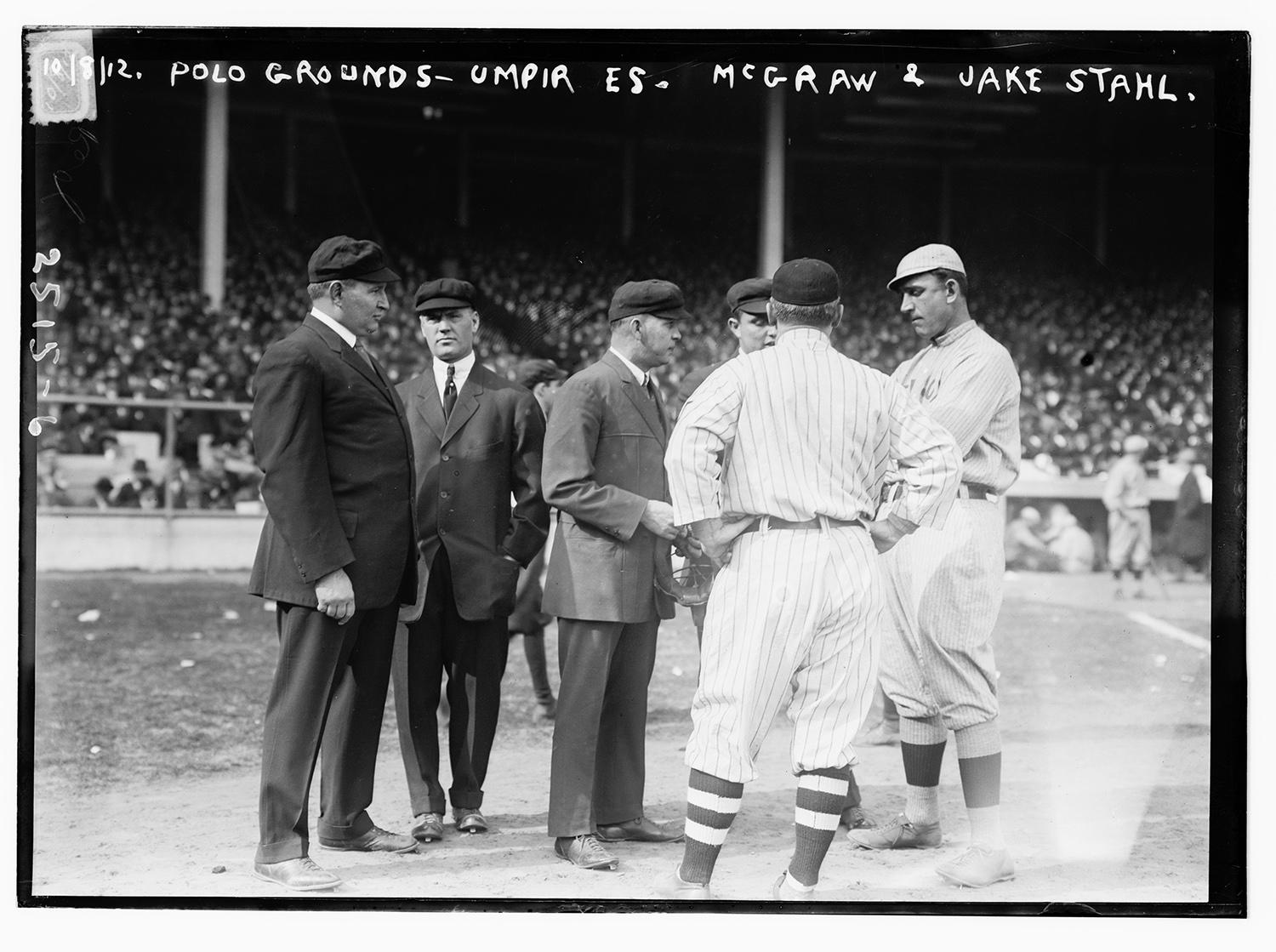 Pictured above from left to right: Umpires Cy Rigler, Silk O'Loughlin, Bill Klem, Billy Evans and managers John McGraw and Jake Stahl at the 1912 World Series. (Photo courtesy of Library of Congress)