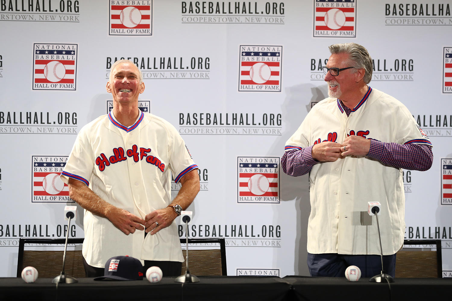 Alan Trammell and Jack Morris try on their new Hall of Fame jerseys following the Modern Baseball Era electee press conference on Dec. 11, 2017. (Alex Trautwig/MLB Photos)
