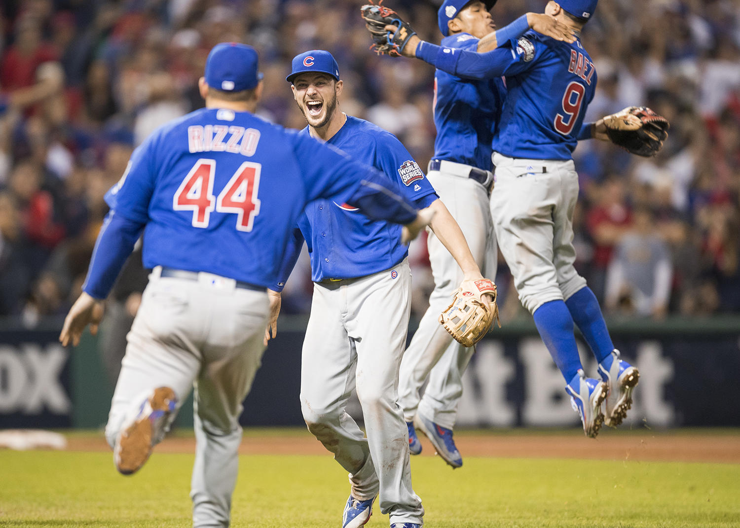 Kris Bryant, Addison Russell, Anthony Rizzo and Javier Baez of the Chicago Cubs celebrate on the field after defeating the Cleveland Indians to win the 2016 World Series at Progressive Field on November 2, 2016 in Cleveland, Ohio. (Jean Fruth / National Baseball Hall of Fame)