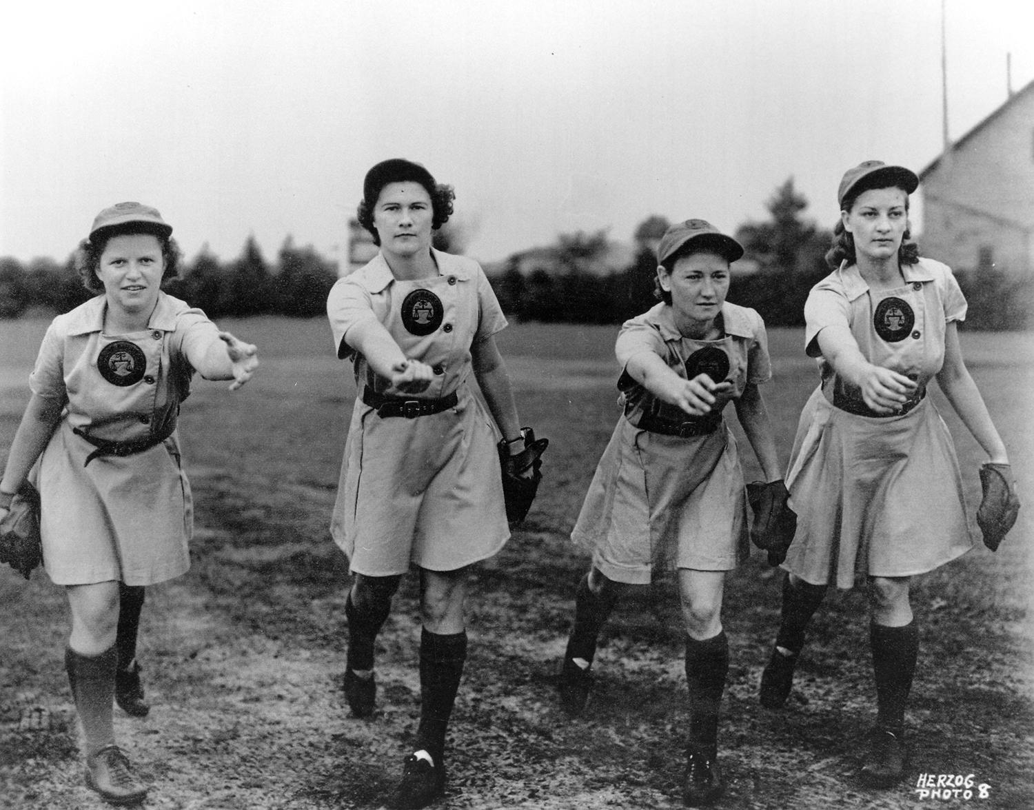Pictured above, pitchers on the 1943 Rockford Peaches warm up prior to a game. From left to right: Mary Pratt, Olive Little, Marjorie Peters and Muriel Coben. (National Baseball Hall of Fame and Museum)
