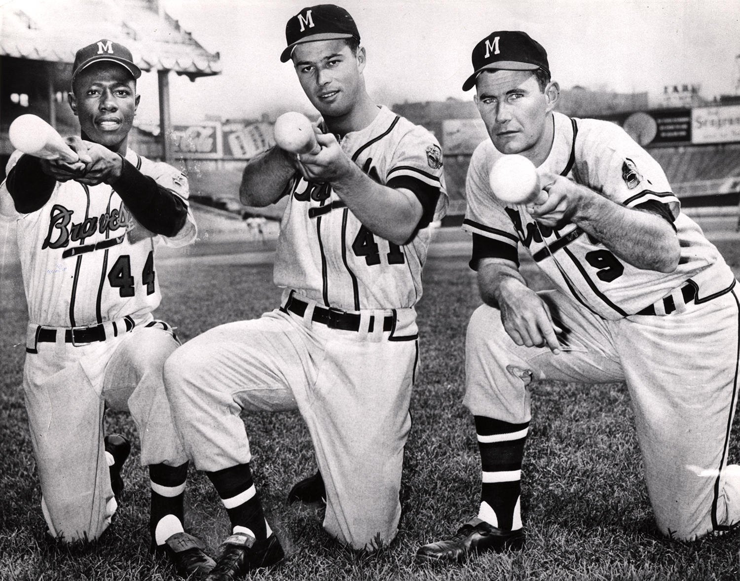 Hank Aaron poses with fellow Hall of Famer Eddie Mathews (center), and Braves first baseman Joe Adcock, while playing for the Milwaukee Braves. (National Baseball Hall of Fame)