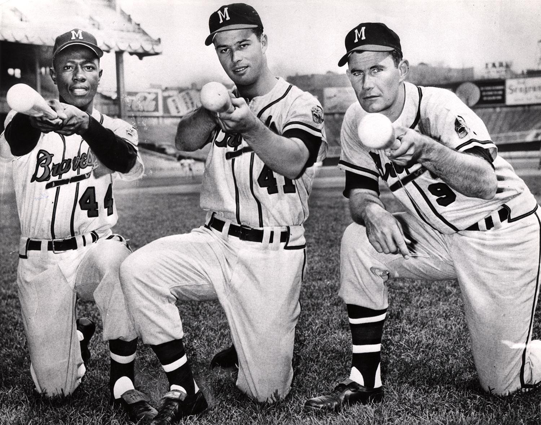 Hank Aaron poses with fellow Hall of Famer Eddie Mathews (center), and Braves first baseman Joe Adcock, while playing for the Milwaukee Braves. (National Baseball Hall of Fame)