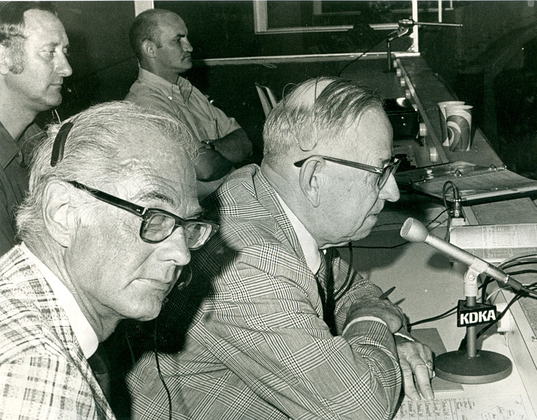 Harold Arlin, speaking into the microphone, on August 30, 1972. Bob Prince is in the forefront, on the left. BL-3050-84 (National Baseball Hall of Fame Library)