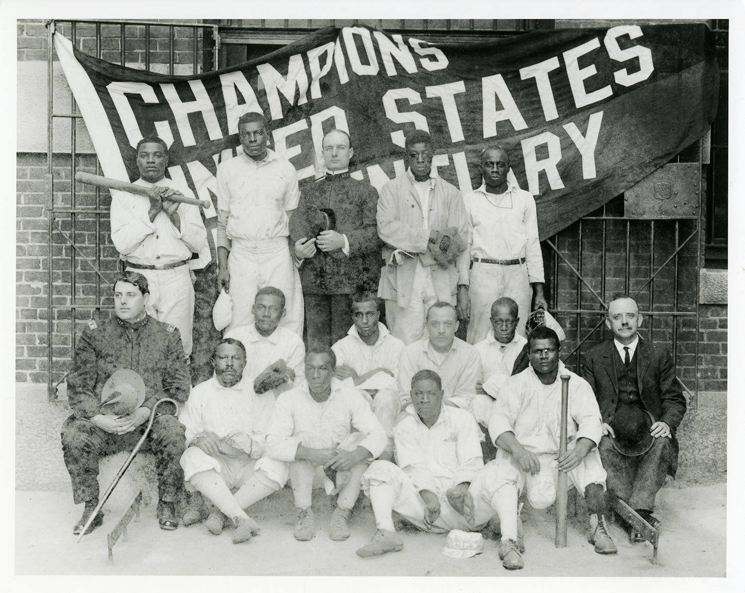 """An April 6, 1913, edition of the <em>Boston Daily Globe</em> told readers that Opening Day at Atlanta's Federal Penitentiary was """"[a]ttended by all the conventional ceremonies of a big league,"""" including a parade led by a prison band, and the raising of the previous year's championship flag, won by the Giants, a team of men from the Penitentiary stone-cutting shop. (National Baseball Hall of Fame)"""