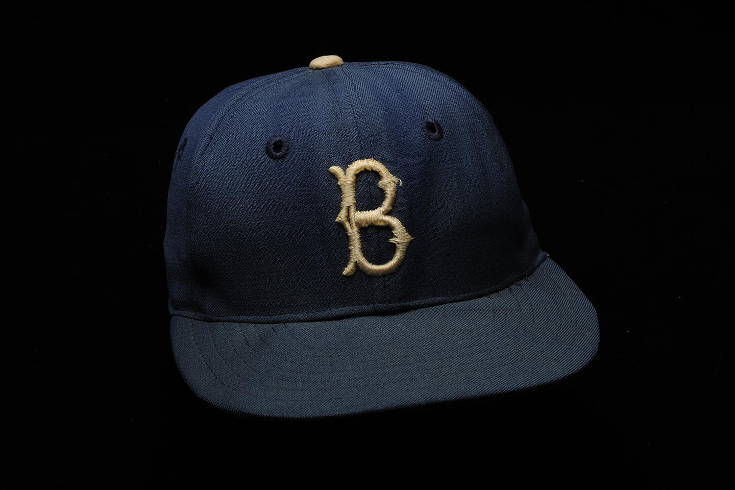 Jackie Robinson wore this cap during the 1955 World Series, during which the Brooklyn Dodgers defeated the New York Yankees in seven games. (Milo Stewart Jr. / National Baseball Hall of Fame and Museum)