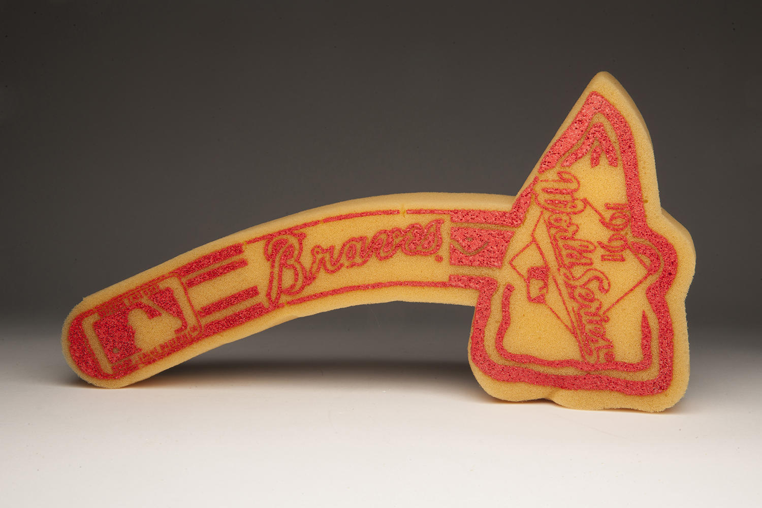 """Braves fans, known for their 'tomahawk chop', used this foam tomahawk to cheer on their team during the 1991 World Series. <a href=""""http://collection.baseballhall.org/islandora/object/islandora%3A262562"""">PASTIME</a> (Milo Stewart Jr. / National Baseball Hall of Fame)"""