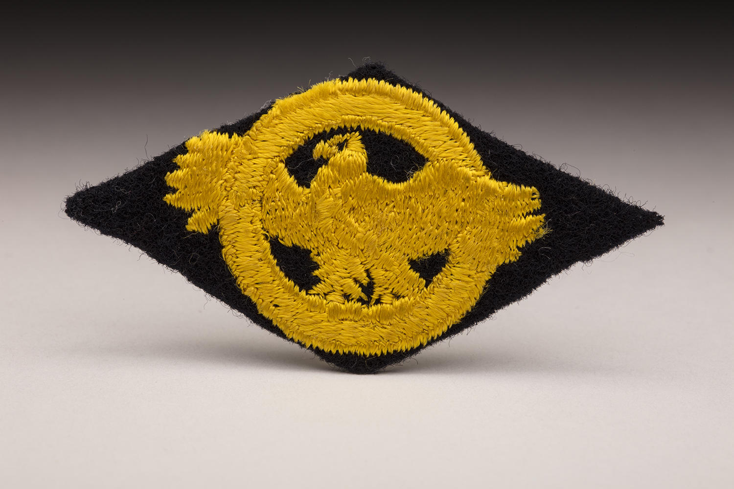 """The """"ruptured duck"""" patch (pictured above) was a source of pride for returning ballplayers who served in World War II. (By Photographer Milo Stewart Jr./National Baseball Hall of Fame and Museum)"""