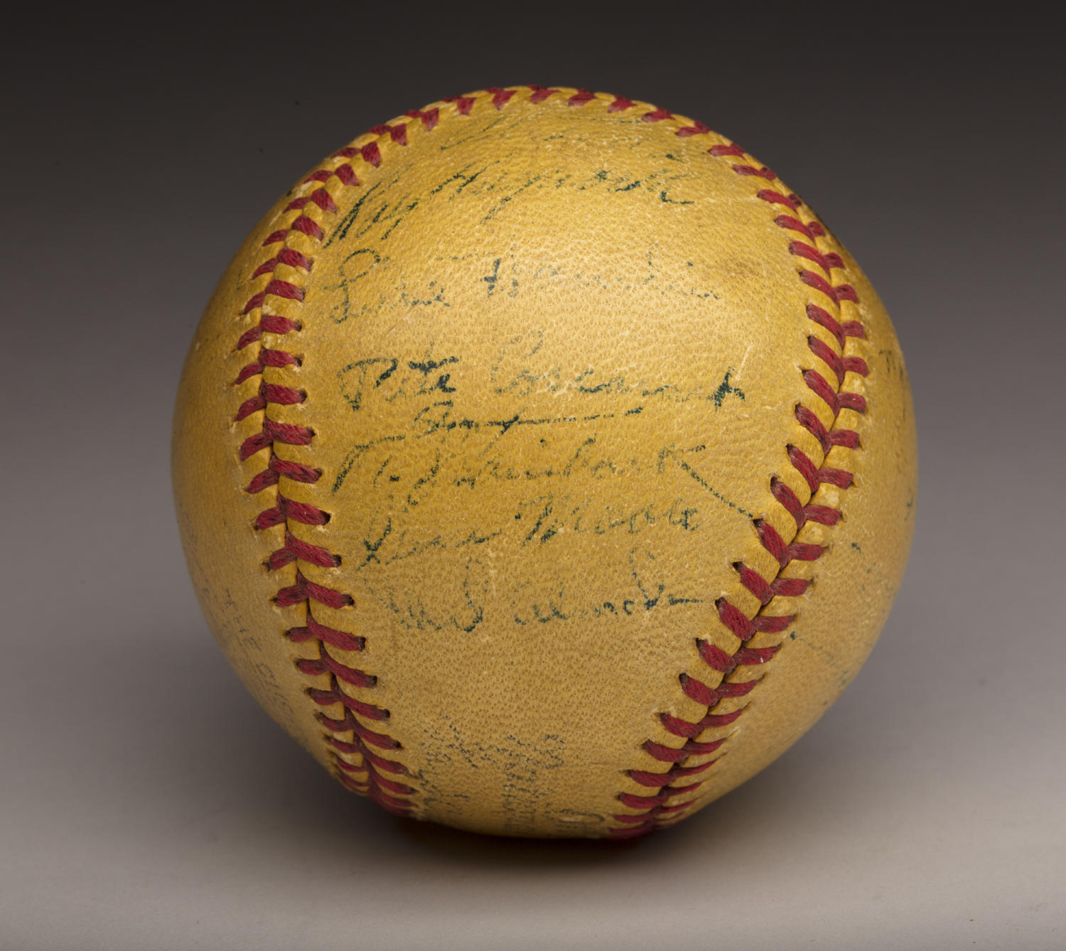 This experimental yellow baseball used during the 1930s was recently donated to the Museum. The autographs were signed by players at Ebbets Field. (By Photographer Milo Stewart Jr./National Baseball Hall of Fame and Museum)