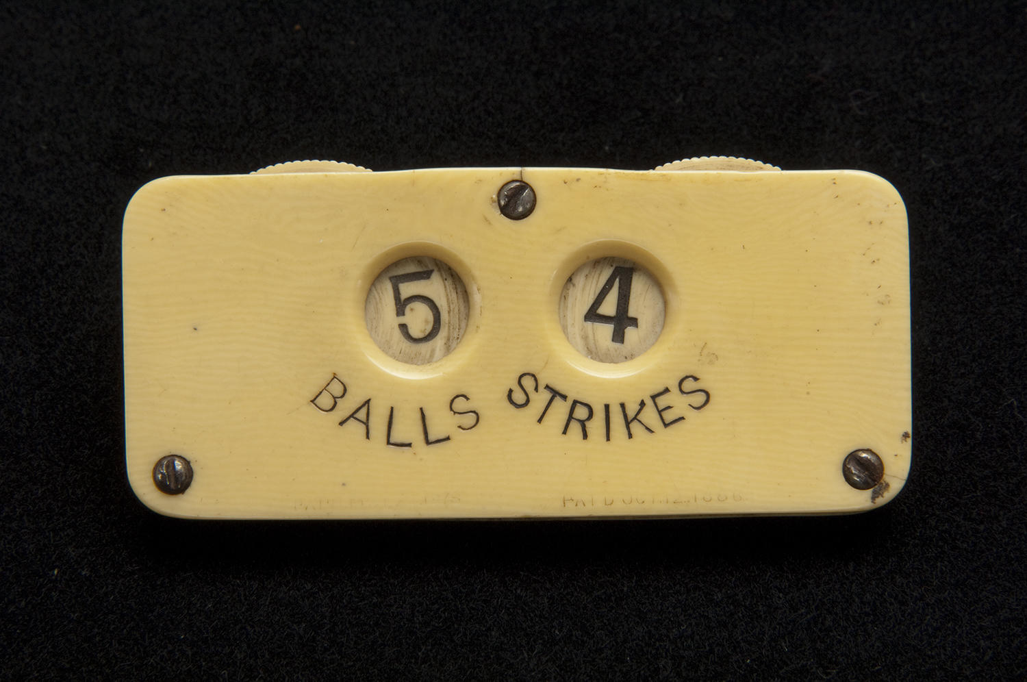 This umpire's indicator was used during the 1887 season, a time when five balls counted as a walk, walks counted as hits, and four strikes were necessary for an out. Such rule changes gave batters more of an advantage. (National Baseball Hall of Fame)