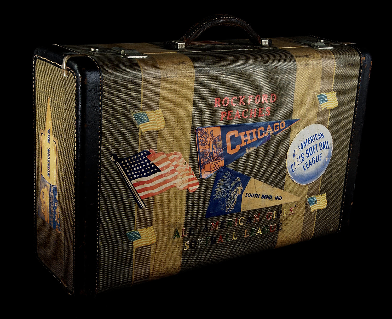 "The reverse side of Mary Pratt's suitcase proudly shows the first team she played for -- the Rockford Peaches -- and the league in which she played, the AAGPBL (then referred to as a ""softball"" league). <a href=""https://collection.baseballhall.org/PASTIME/mary-pratt-suitcase-1943-1947-2"">PASTIME</a> (Milo Stewart Jr. / National Baseball Hall of Fame and Museum)"