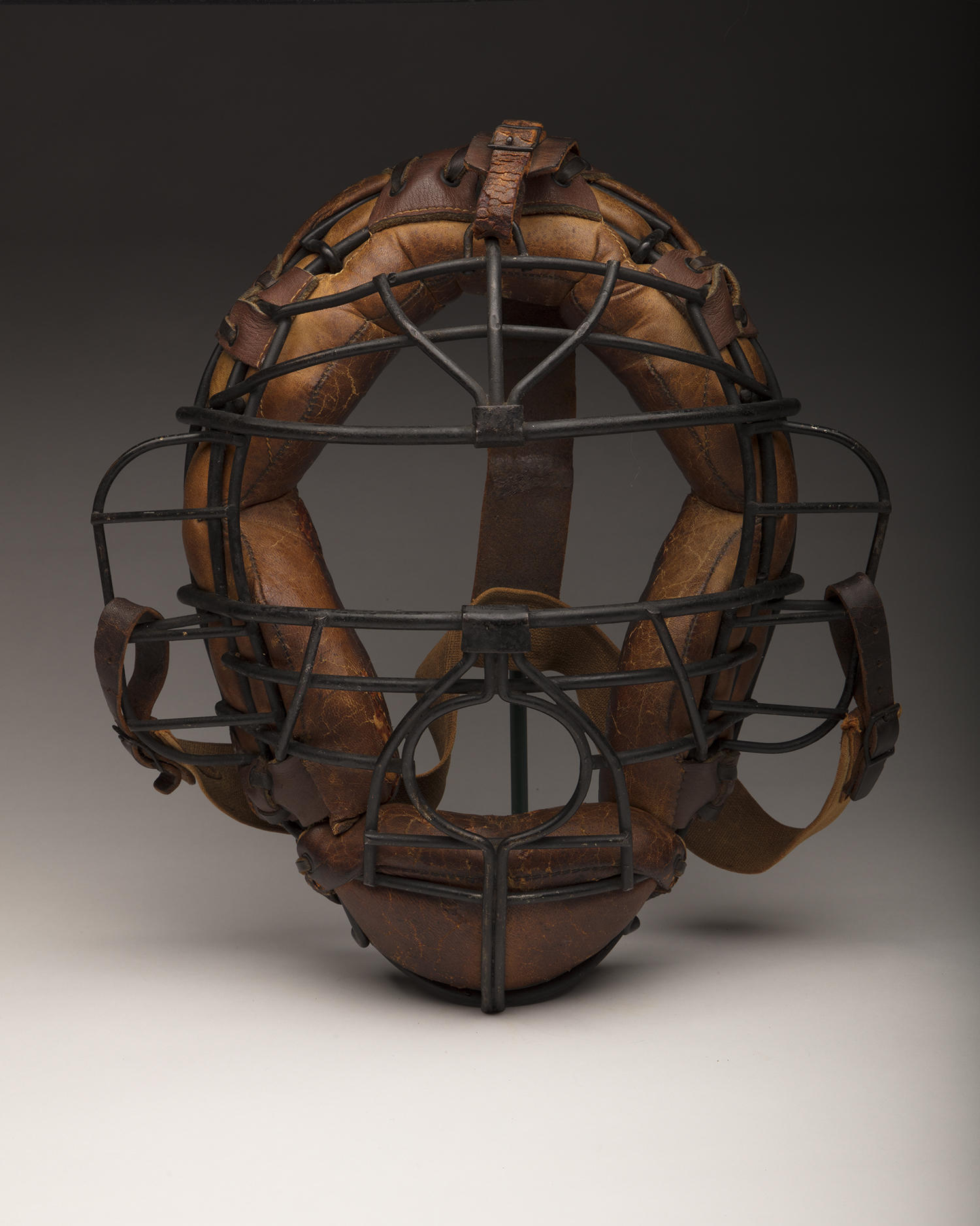 This catcher's mask, worn by Hall of Famer Mickey Cochrane, has been conserved. (Milo Stewart Jr. / National Baseball Hall of Fame and Museum)