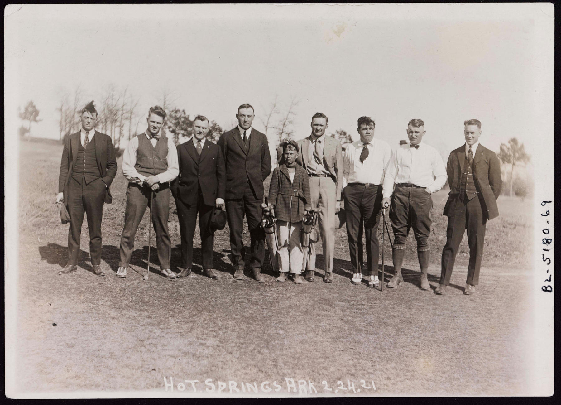 Standing left to right, Clyde Milan, Waite Hoyt, Tommy Griffith, Jeff Pfeffer, unidentified caddy, Walter Johnson, Babe Ruth, Carl Mays, and Harry Harper.  The photograph was taken at Hot Springs, Ark. on February 24, 1921.   BA-PF-Walter-Johnson-Misc-003  (National Baseball Hall of Fame and Museum)