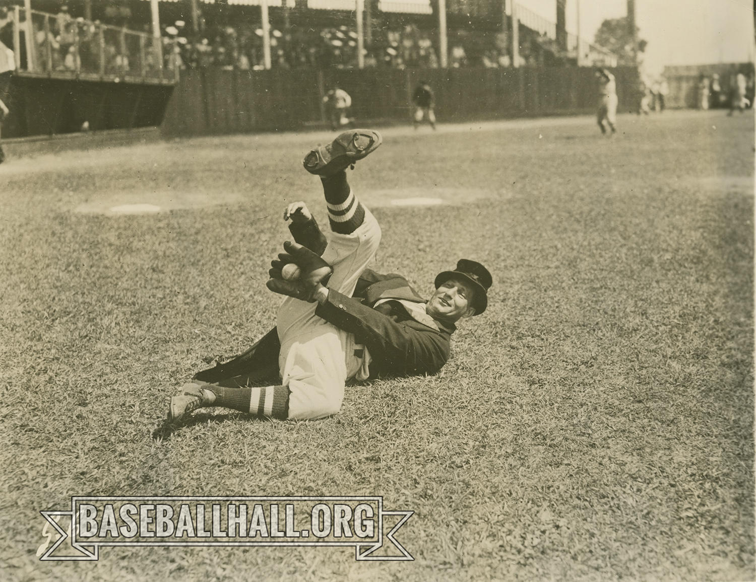 """As part of his Baseball Clown routine, Al Schacht (pictured above) would wear a swallowtail tuxedo jacket and top hat, now part of the Hall of Fame's collection, and occasionally ate a fine meal on home plate between innings. <a href=""""https://collection.baseballhall.org/PASTIME/al-schacht-photograph-undated-0"""">PASTIME</a> (National Baseball Hall of Fame and Museum)"""