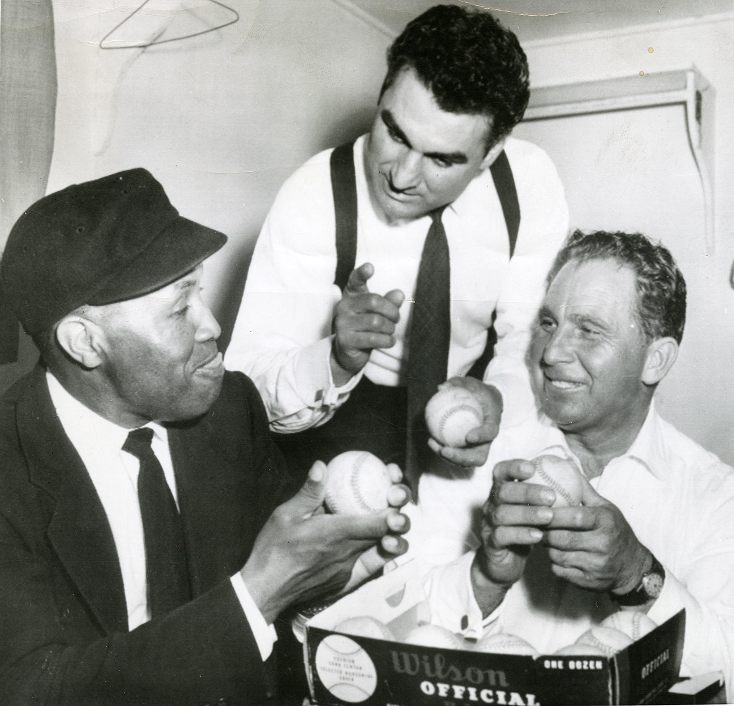 """Cece Carlucci (center) was a mentor for Emmett Ashford (left) while he was working in the Pacific Coast League. Mickey Hanich (right) also worked as an umpire in the PCL. <a href=""""http://collection.baseballhall.org/islandora/object/islandora%3A299332"""">PASTIME</a> (National Baseball Hall of Fame and Museum)"""
