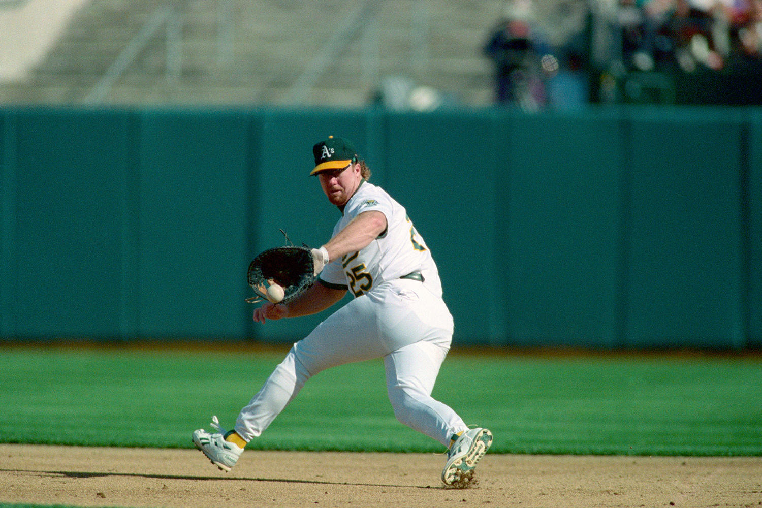 Mark McGwire started his career as a third baseman but quickly moved to first base, where he won a Gold Glove Award in 1990. (Brad Mangin / National Baseball Hall of Fame)