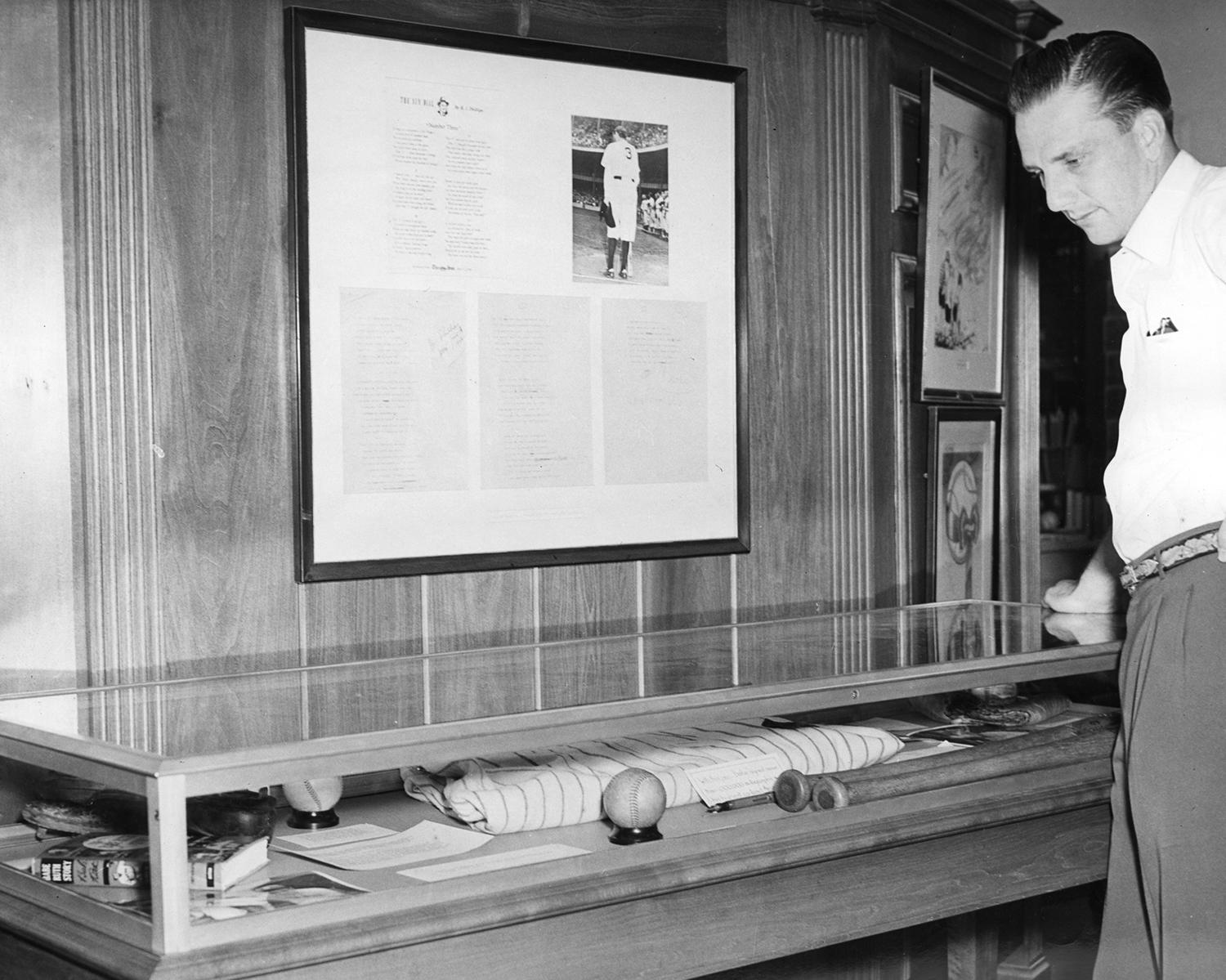 Future Hall of Famer Ralph Kiner looks at an exhibit case in the Museum in 1949, just three years after his MLB debut. (National Baseball Hall of Fame and Museum)
