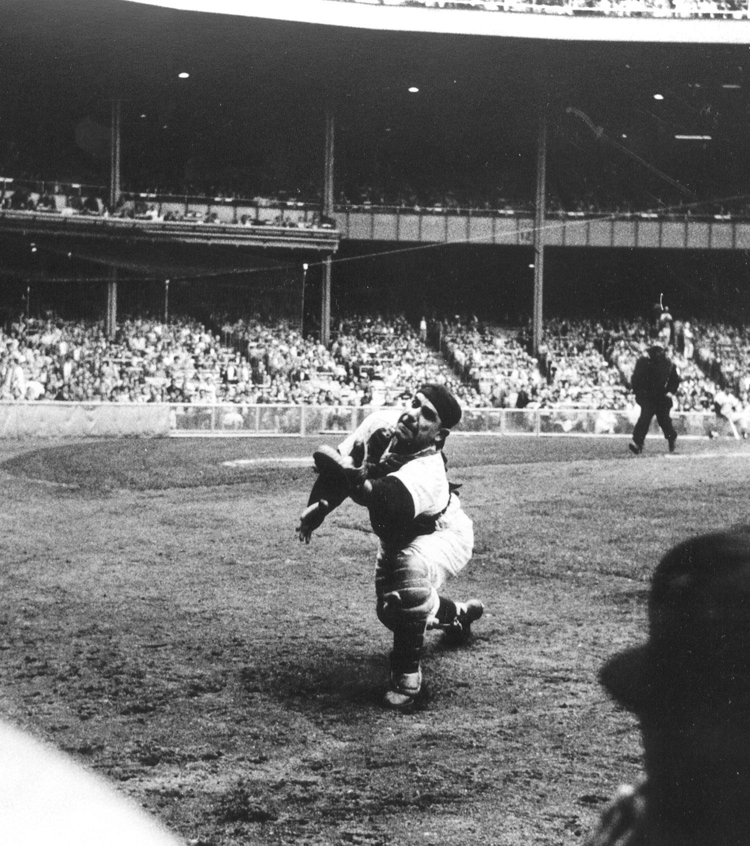 This image of Yogi Berra chasing down a foul ball is one of thousands that need to be preserved. (Arthur Rickerby / National Baseball Hall of Fame and Museum)