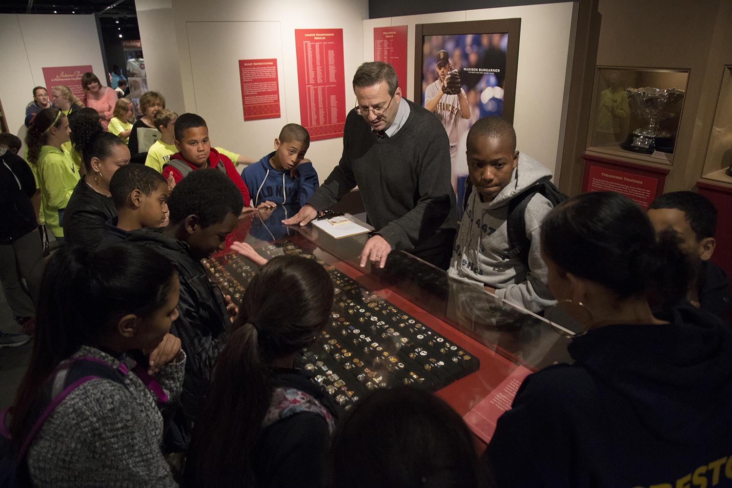 Manager of digital & outreach learning Bruce Markusen shows the World Series rings in the Hall of Fame collection to students visiting from the Creston Academy. (Milo Stewart Jr./National Baseball Hall of Fame and Museum)