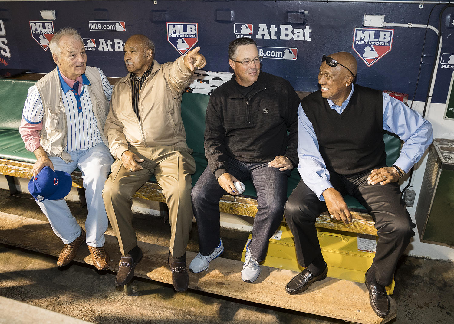 Actor Bill Murray (far left) and Hall of Famers (l to r) Billy Williams, Greg Maddux and Fergie Jenkins talk in the dugout before the start of Game 4 of the 2016 World Series between the Cleveland Indians and the Chicago Cubs at Wrigley Field on Oct. 29, 2016 in Chicago. (Jean Fruth / National Baseball Hall of Fame and Museum)
