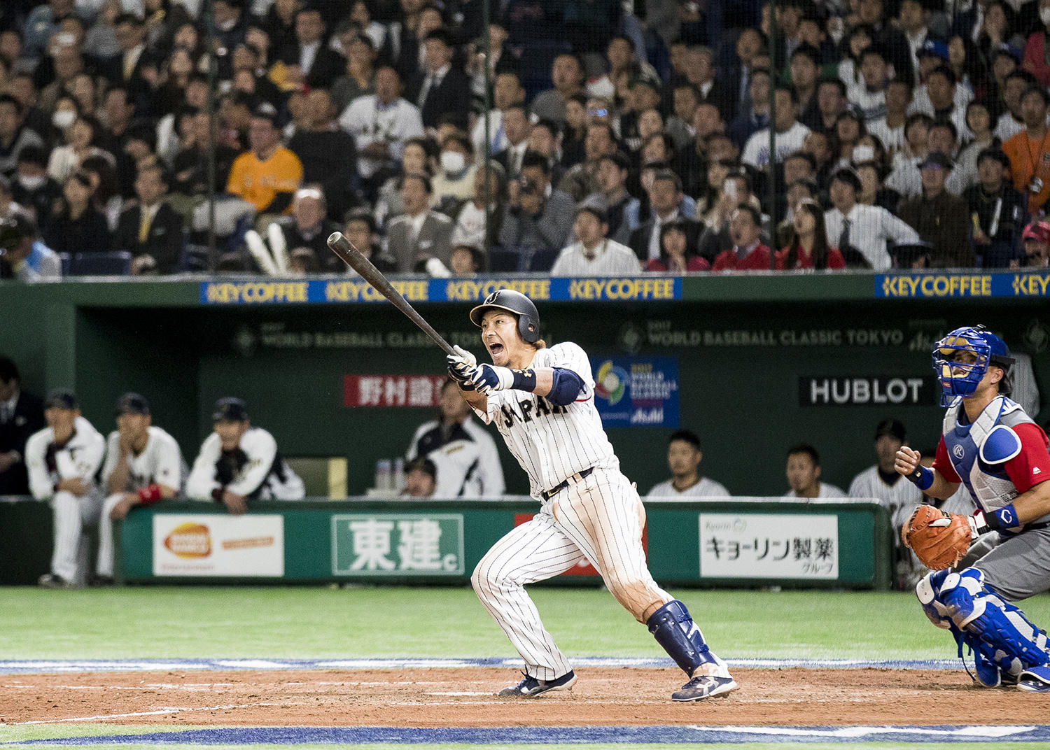 231e8e0f81065 Team Samurai Japan third baseman Nobuhiro Matsuda can t contain his  excitement as he watches his home run ball sail into the left field stands  in his team s ...
