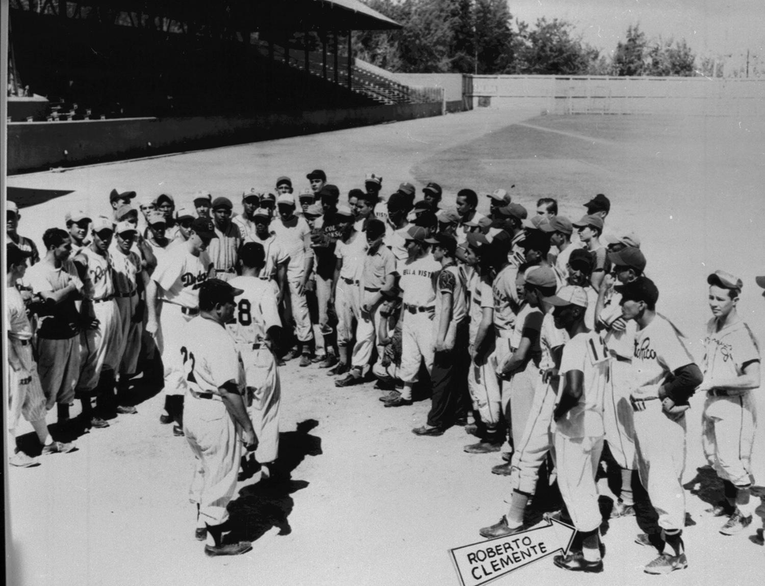Roberto Clemente, pictured above at the Brooklyn Dodgers' tryout camp in 1954. On the strength of a recommendation by Clyde Sukeforth, the Pirates took Clemente in the Rule 5 Draft following the 1954 season. (National Baseball Hall of Fame and Museum)