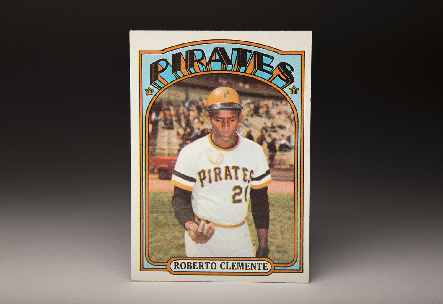 On Roberto Clemente's 1972 Topps card, the photographer captures him in a candid moment, tossing a baseball during a pregame moment at Shea Stadium. (By Photographer Milo Stewart Jr. / National Baseball Hall of Fame and Museum)