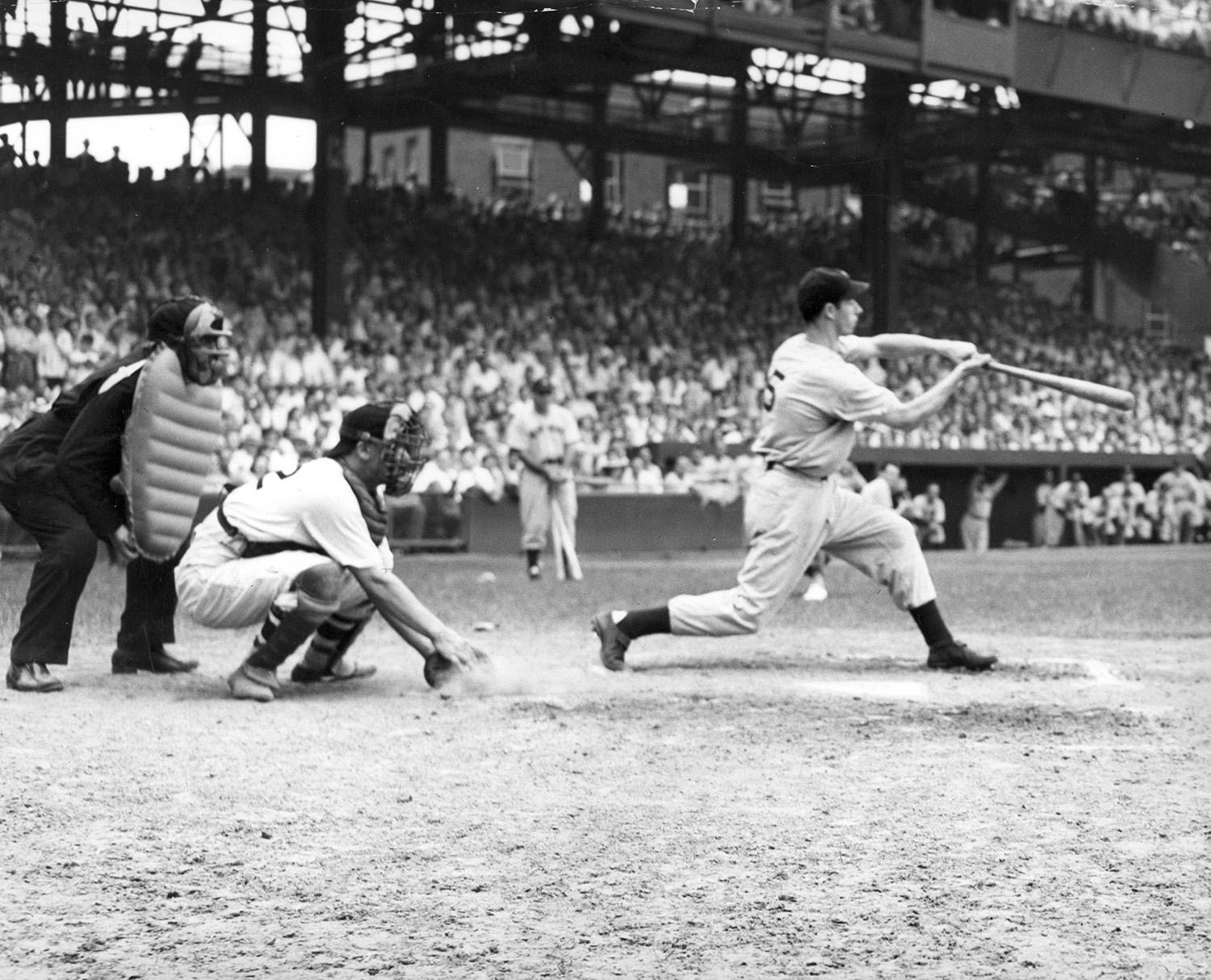 Joe DiMaggio, pictured above batting in his 42nd consecutive game, still holds the record for the longest hit streak in MLB history, hitting safely in 56 straight games in 1941. (National Baseball Hall of Fame and Museum)