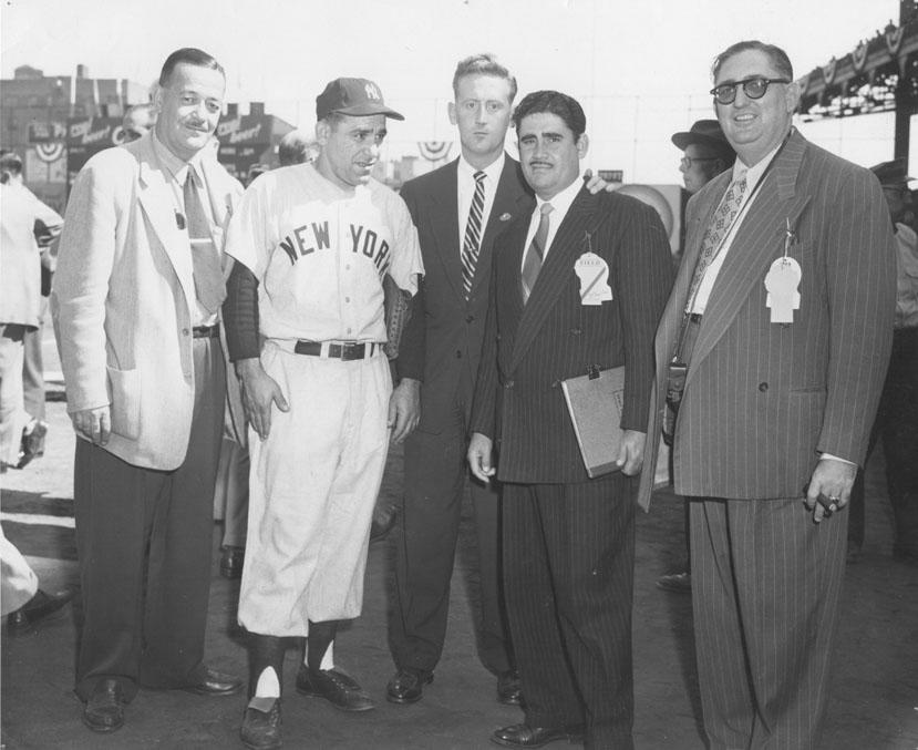 Vin Scully (center) poses with Yogi Berra (center left) and Felo Ramírez (center right), who like Scully was honored with the Hall of Fame's Ford C. Frick Award for broadcasters. (National Baseball Hall of Fame)