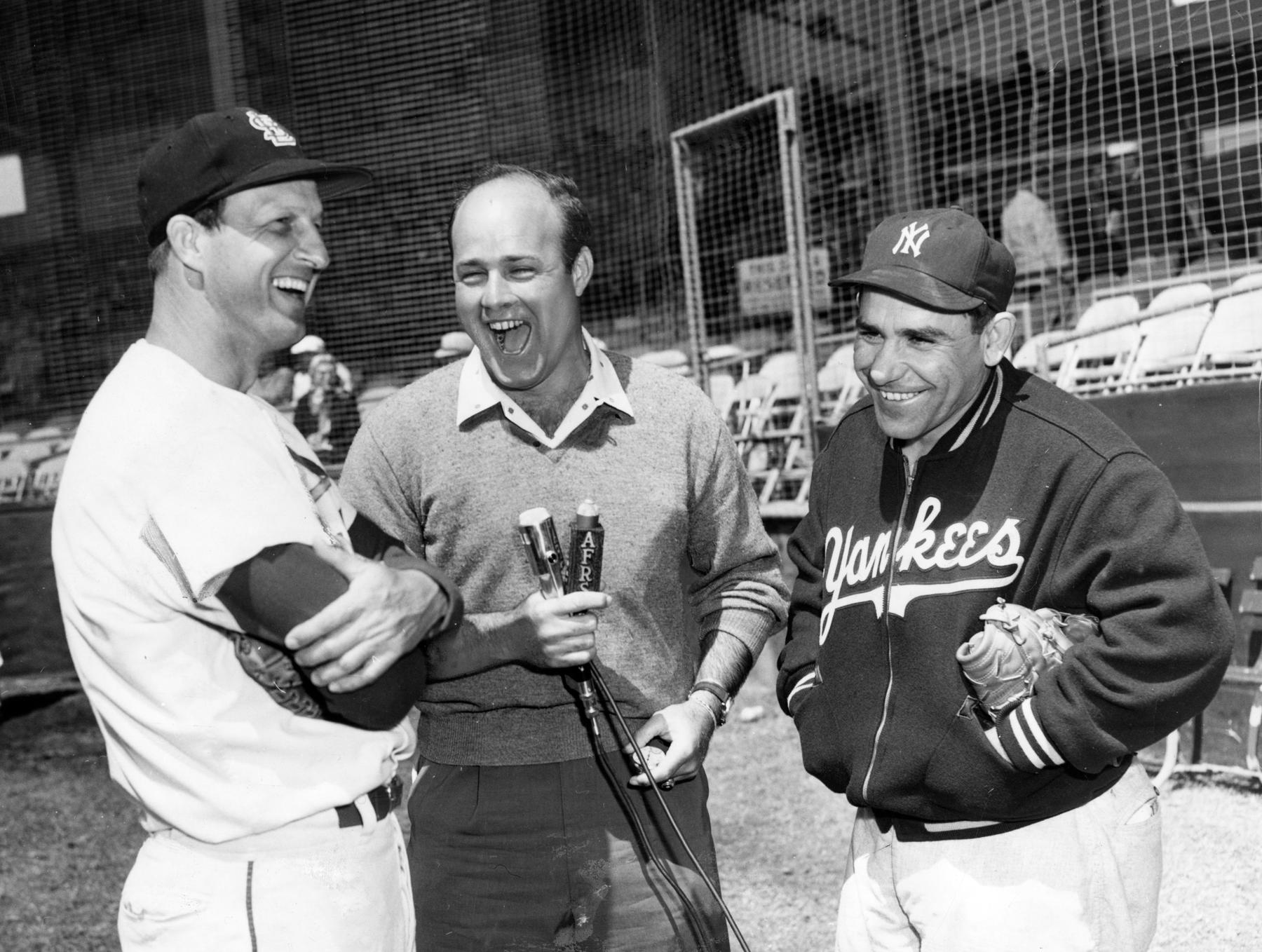 Former big league catcher Joe Garagiola, who became a broadcaster, talks with St. Louis Cardinals Stan Musial and New York Yankees Yogi Berra during spring training in Florida, 1960. BL-2081.68WTI (National Baseball Hall of Fame Library)