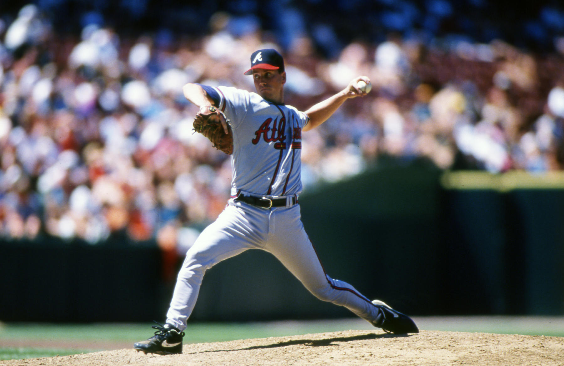 Glavine moves to the plate to deliver one of his deadly change-ups. BL-12-2013-601 (Brad Mangin / National Baseball Hall of Fame Library)