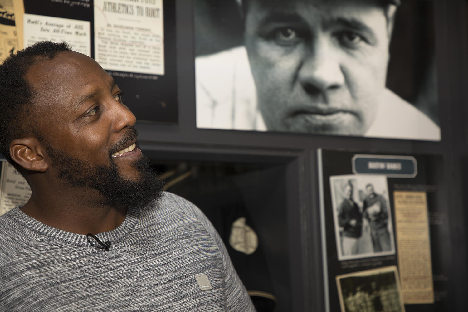 Vladimir Guerrero walks through the <em>Babe Ruth: His Life and Legend</em> exhibit at the Hall of Fame. (Milo Stewart Jr./National Baseball Hall of Fame and Museum)