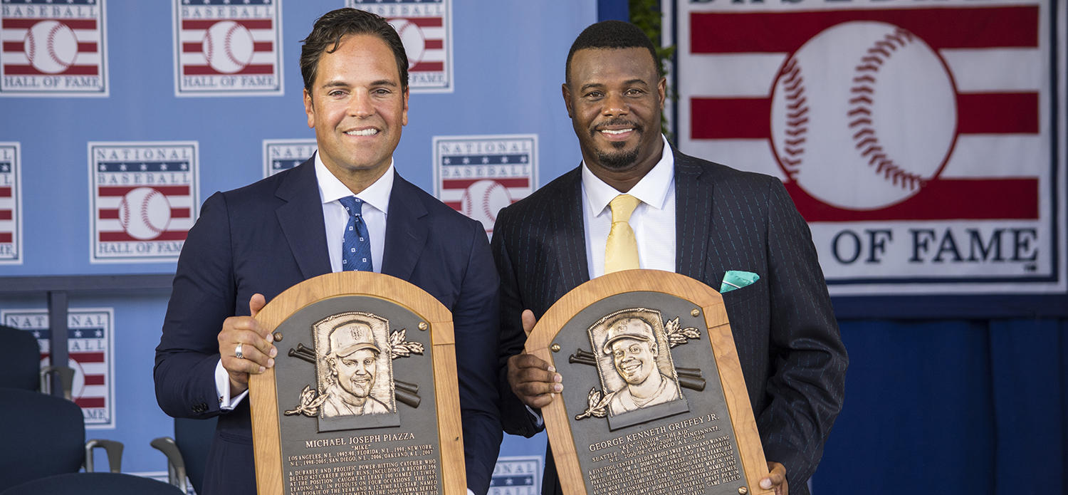 Mike Piazza and Ken Griffey Jr. pose with their new plaques, shortly after the 2016 <em> Induction Ceremony </em> at Clark Sports Center. (Milo Stewart Jr. / National Baseball Hall of Fame)
