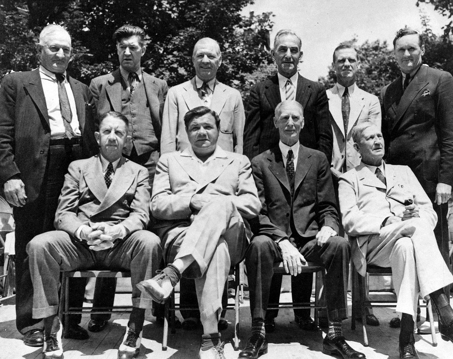 Pictured above, a group shot of the living members of the Hall of Fame Classes of 1936, 1937, 1938 and 1939, at the first Induction Ceremony (missing from photo: Ty Cobb). Back row (left to right): Honus Wagner, Grover Cleveland Alexander, Tris Speaker, Nap Lajoie, George Sisler, and Walter Johnson. Front row (left to right): Eddie Collins, Babe Ruth, Connie Mack and Cy Young. (National Baseball Hall of Fame)