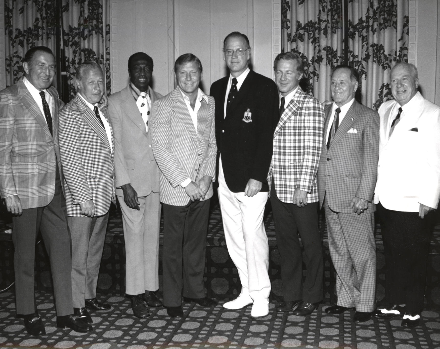 From left, National League President Chub Feeney, American League President Lee MacPhail, inductees Cool Papa Bell and Mickey Mantle, Commissioner Bowie Kuhn, inductees Whitey Ford and Jocko Conlan and former NL President Warren Giles stand for a photo during the 1974 Hall of Fame Weekend. BL-6450-76 (National Baseball Hall of Fame Library)