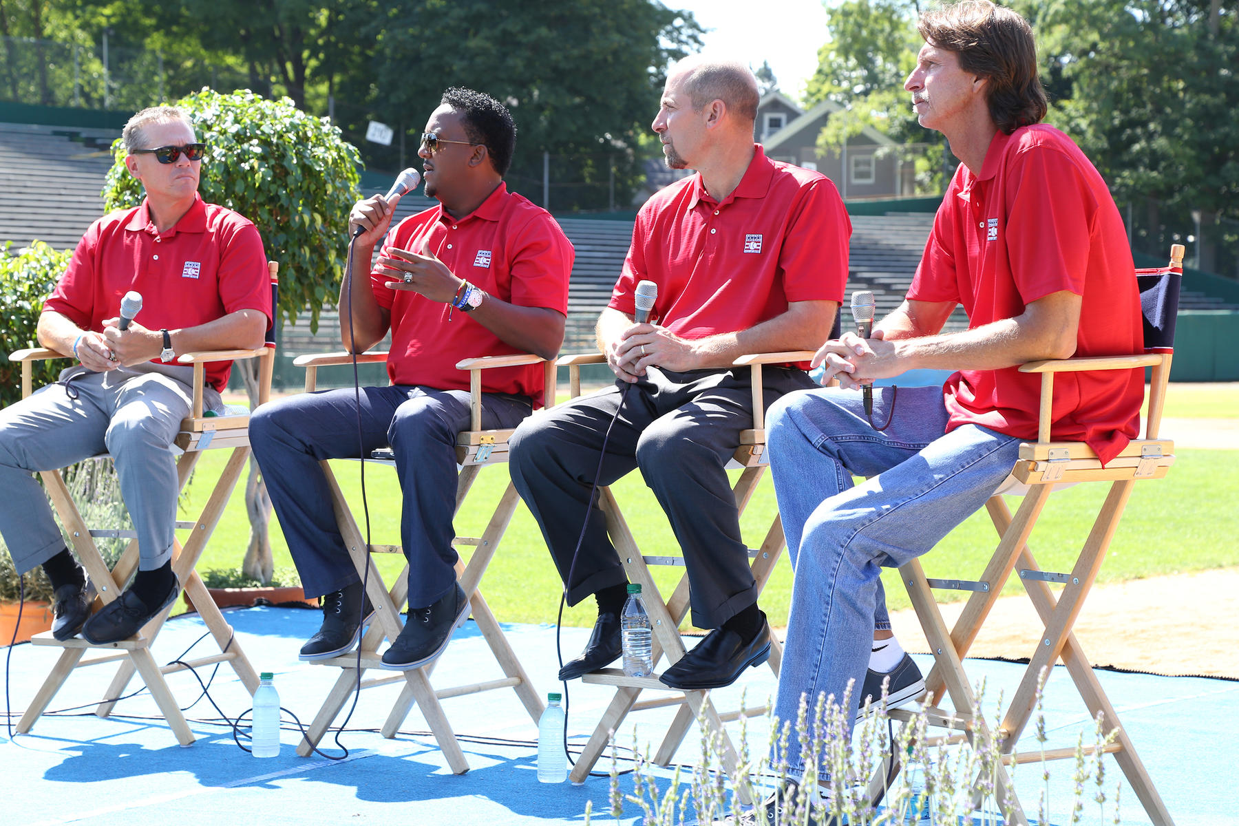 From left, Class of 2015 inductees Craig Biggio, Pedro Martínez, John Smoltz and Randy Johnson reminisce on their Hall of Fame Weekend experiences during the Legends of the Game Roundtable at Cooperstown's Doubleday Field. (Parker Fish / National Baseball Hall of Fame)