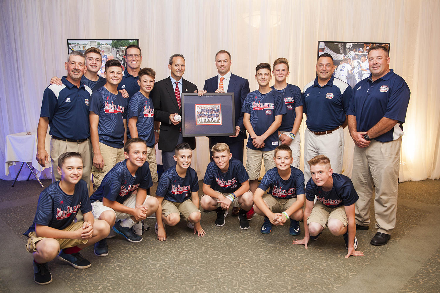 The Maine-Endwell Little League team pictured with National Baseball Hall of Fame President Jeff Idelson, who spoke at their banquet earlier this year. Also pictured (holding the photo) is Hall of Fame Board of Director's member and Legendary Pictures CEO Thomas Tull, who is a proud alumnus of the Maine-Endwell Little League program. (National Baseball Hall of Fame)