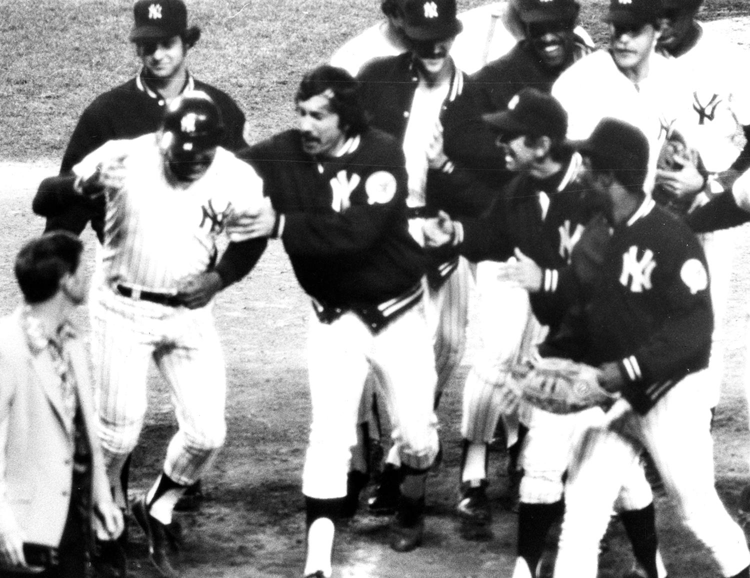 Reggie Jackson celebrates with his Yankees teammates after hitting a home run during the 1977 season. (National Baseball Hall of Fame and Museum)