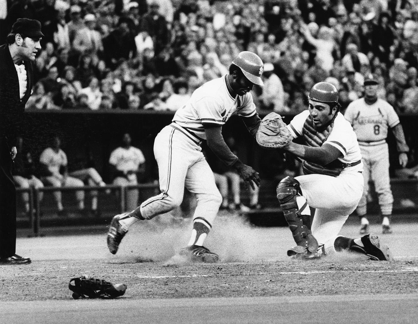 Two future Hall of Famers square off against each other, as Lou Brock tries to sneak past Johnny Bench to steal home. (National Baseball Hall of Fame)
