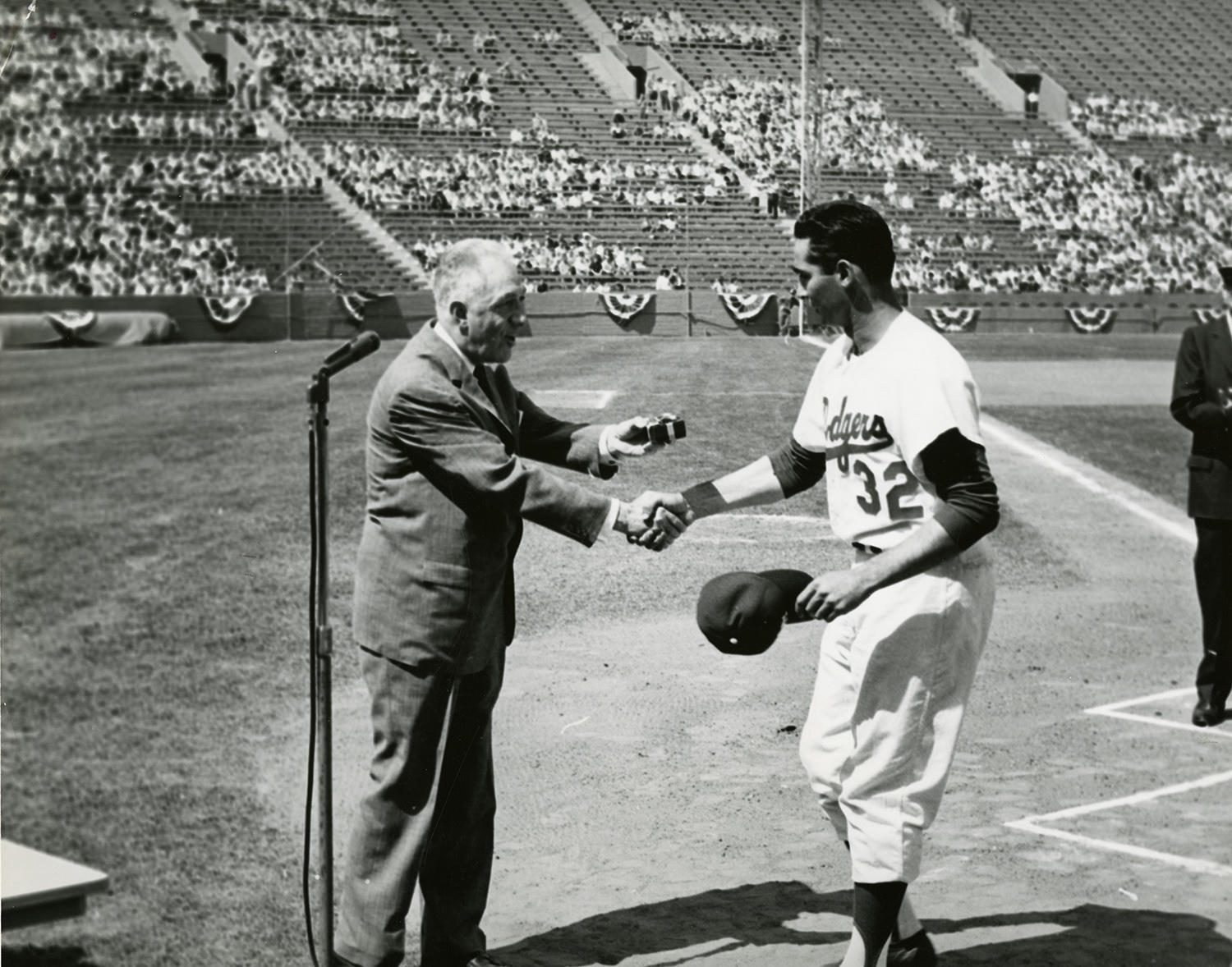 Sandy Koufax accepts his 1959 World Series ring from Commissioner Ford Frick in 1960. (National Baseball Hall of Fame and Museum)