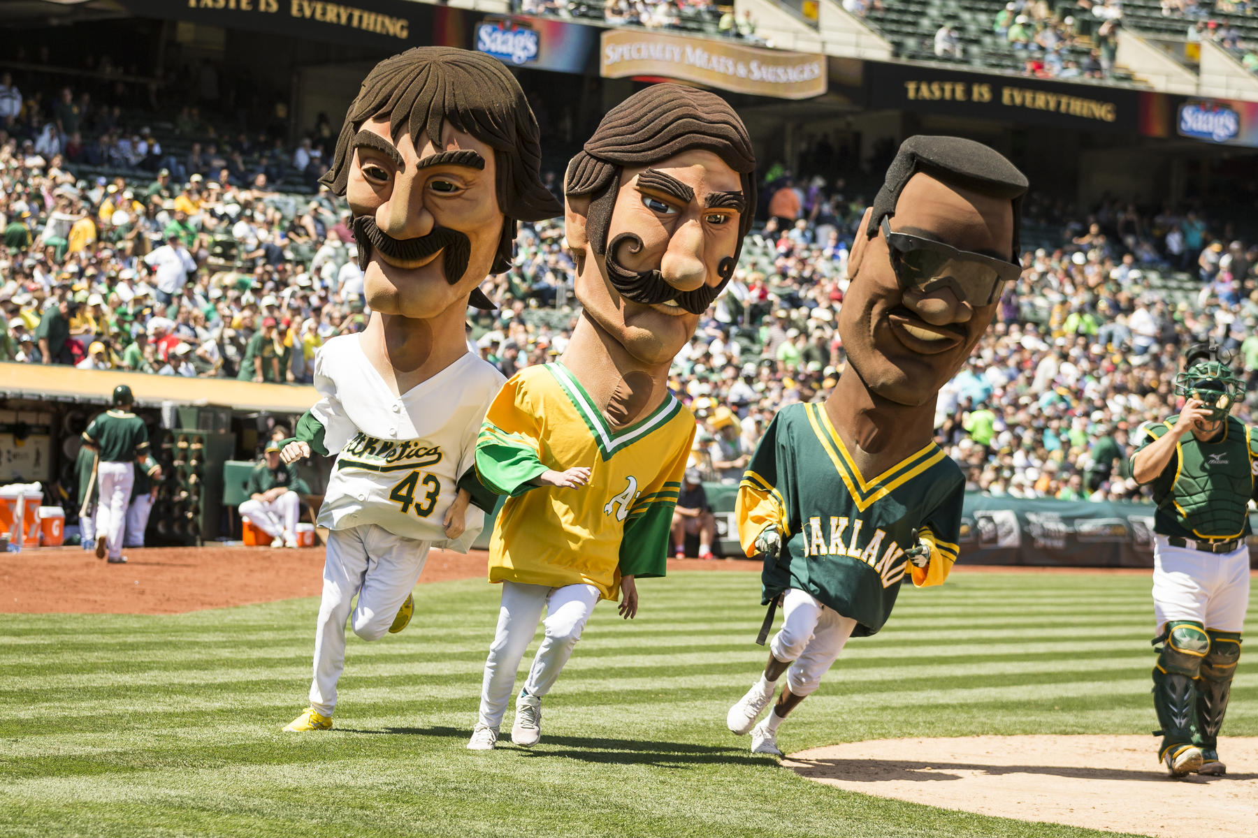 Mascots of Rickey Henderson, Dennis Eckersley and Rollie Fingers run in the Oakland Athletics' Hall of Fame race during the game between the Athletics and the Boston Red Sox at O.co Coliseum on May 13, 2015, in Oakland, Calif. (Jean Fruth / National Baseball Hall of Fame)