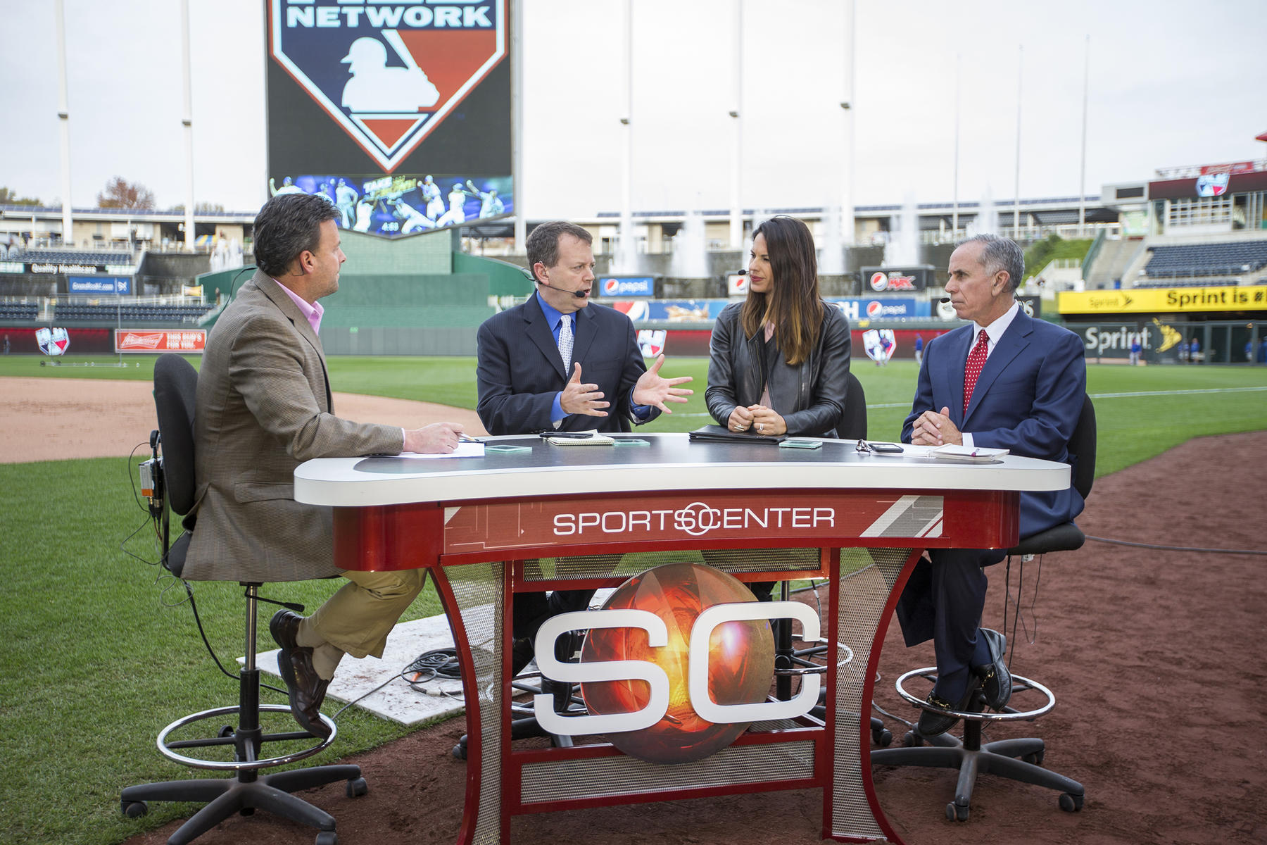 ESPN Baseball Tonight broadcasters (from left) Karl Ravech, Buster Olney, Jessica Mendoza and Tim Kurkjian talk on set the day before Game 1 of the 2015 World Series on Oct. 26, 2015 at Kauffman Stadium in Kansas City, Mo. (Jean Fruth / National Baseball Hall of Fame)