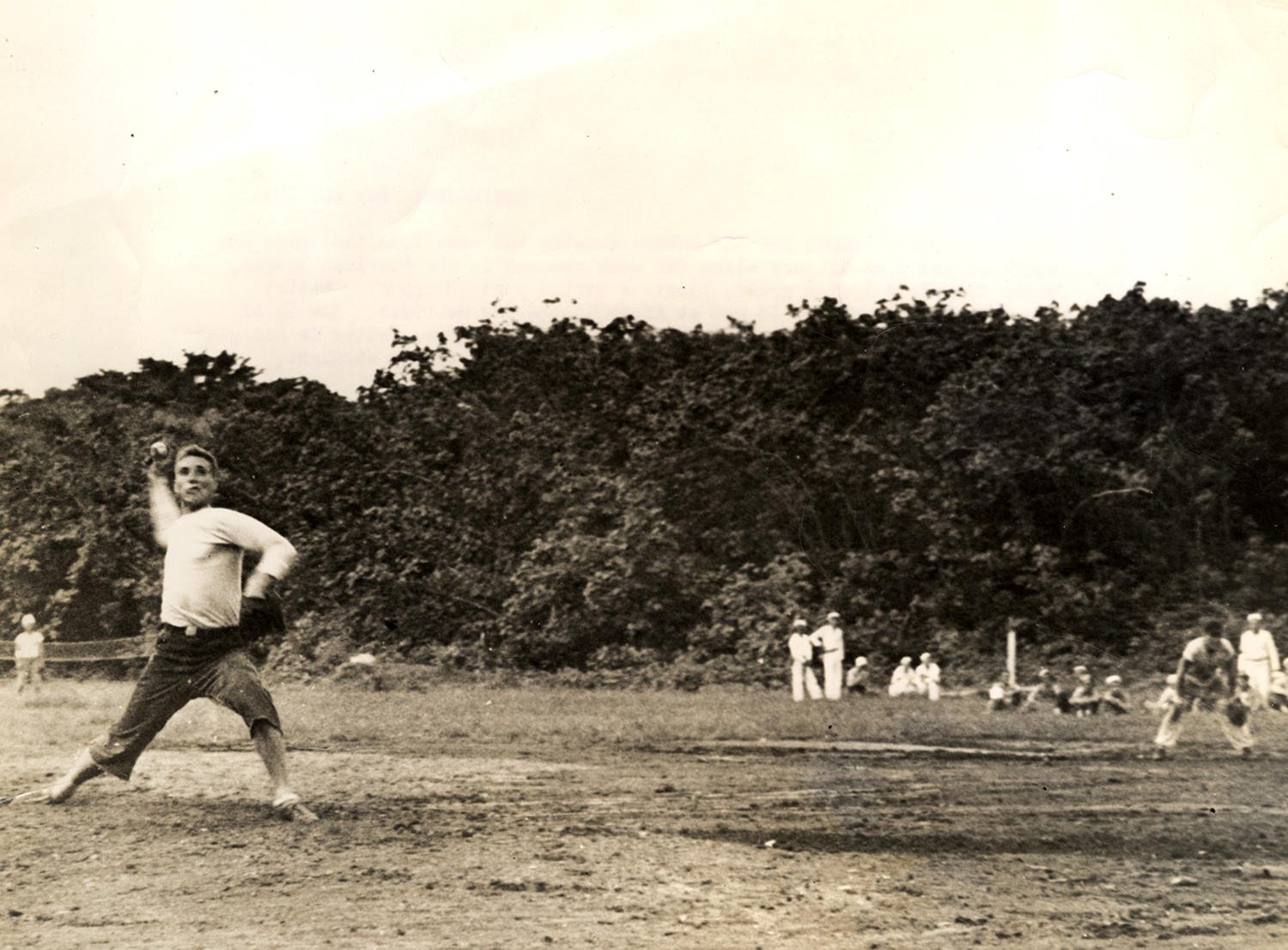 Bob Feller pitches in a recreational game while serving in the Navy during World War II. (National Baseball Hall of Fame)