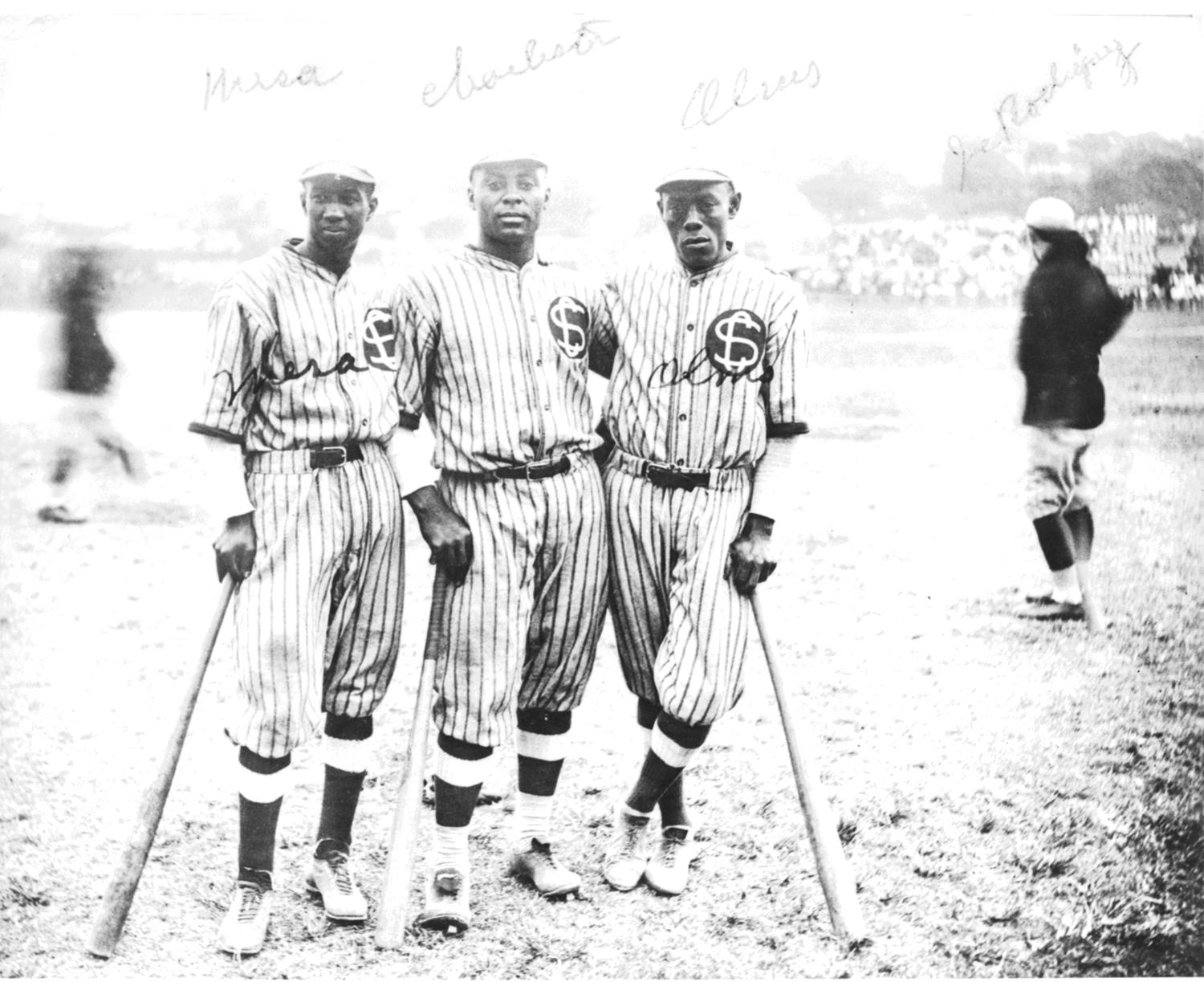 It was common for players to travel to Cuba to play winter ball with various teams, including the Cuban Stars, with whom Cristóbal Torriente began his baseball career with in 1913. Pictured above, are Pablo Mesa, Hall of Famer Oscar Charleston and Alejandro Olms, at Almendares Park in Havana. (National Baseball Hall of Fame)