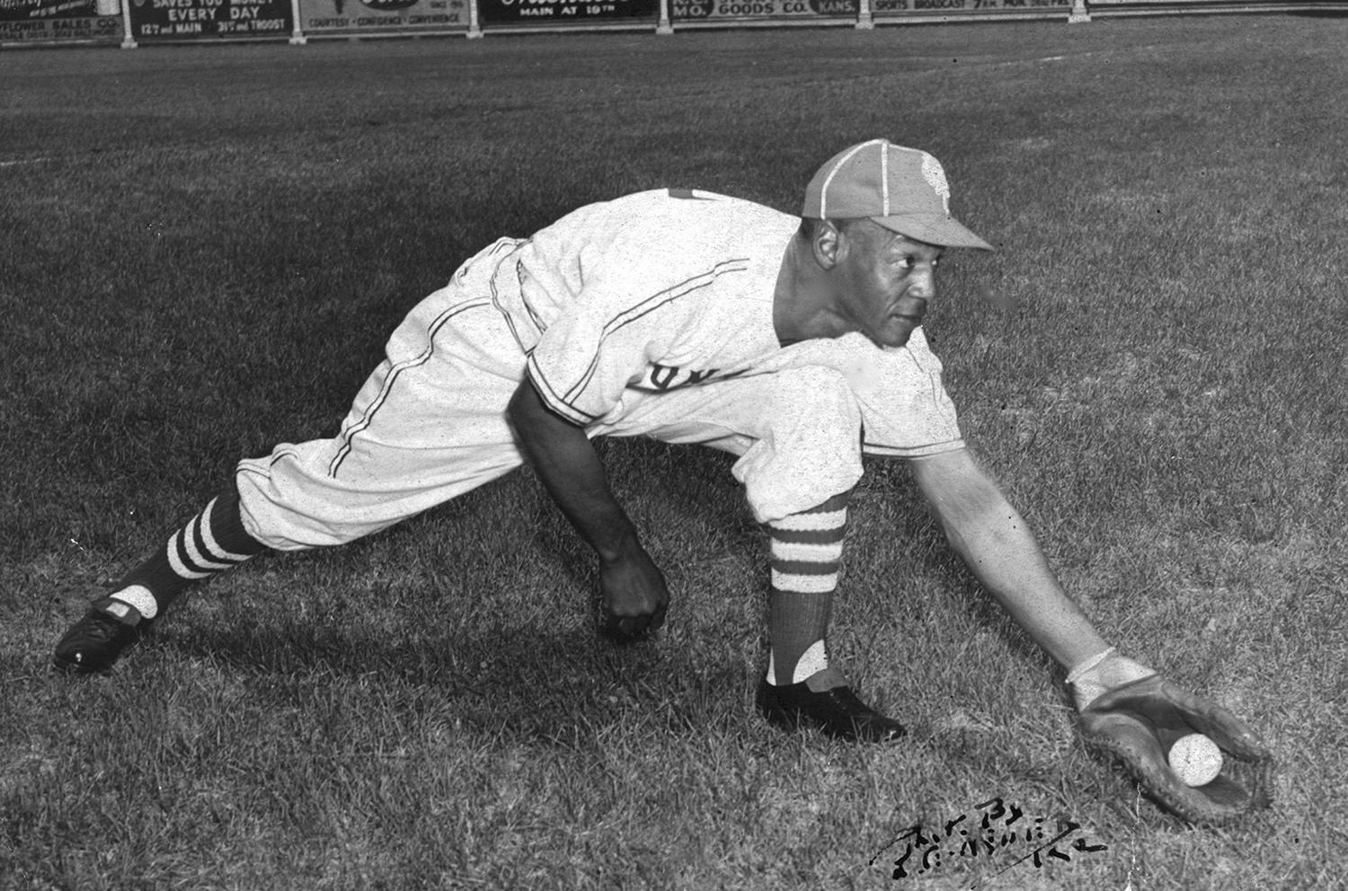 """Buck O'Neill (pictured above) was manager of the Kansas City Monarchs when George Altman made the team in 1955. He taught Altman the proper fundamentals of playing first base, and was reunited with him years later when Altman joined the Chicago Cubs. <a href=""""http://collection.baseballhall.org/PASTIME/oneil-buck-fielding-photograph-undated"""">PASTIME</a> (National Baseball Hall of Fame and Museum)"""