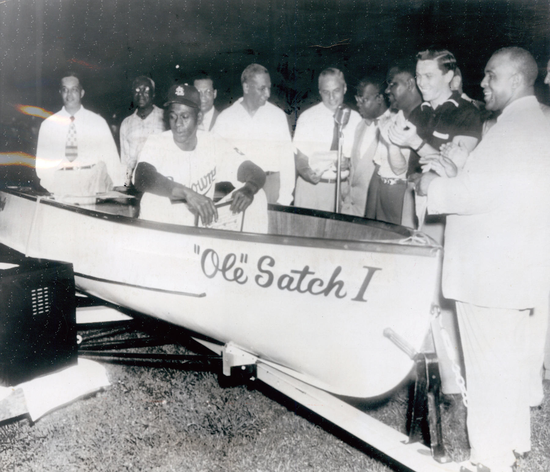 Satchel Paige sits in a boat named 'Ole Satch I' given to him by his St. Louis Browns owner Bill Veeck in 1952. Paige was 46 at the time. BL-4293-76 (National Baseball Hall of Fame Library)